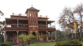 A multi-storey church building.