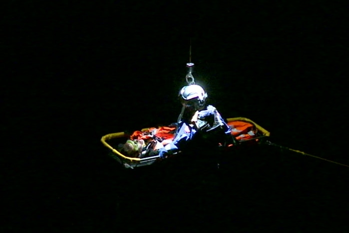 The 18-year-old in a stretcher being rescued.