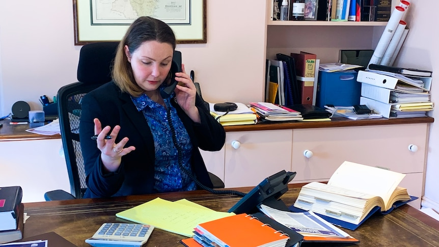 Lucy Sunman on the phone in her office