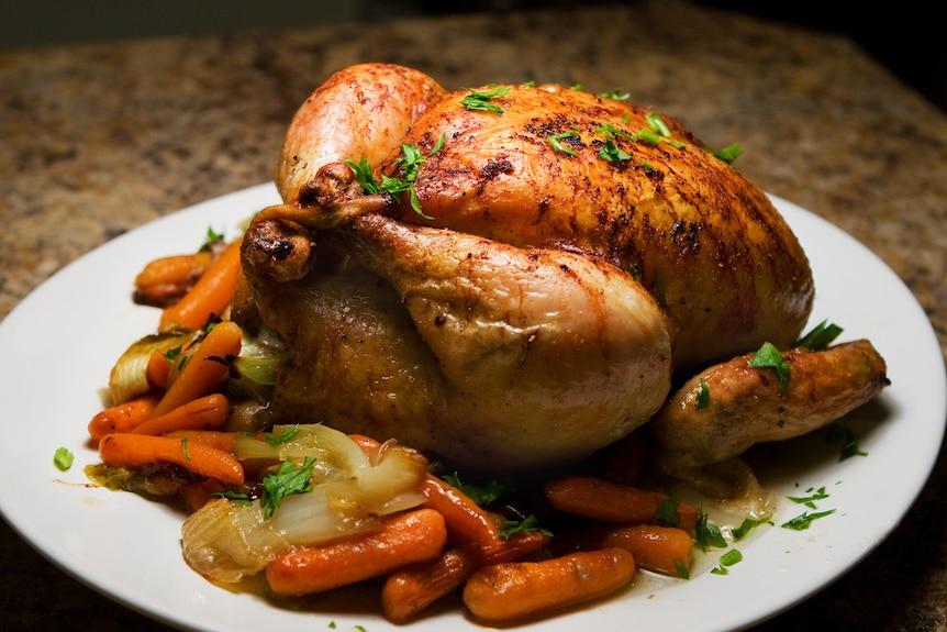 Roast chicken on a plate.