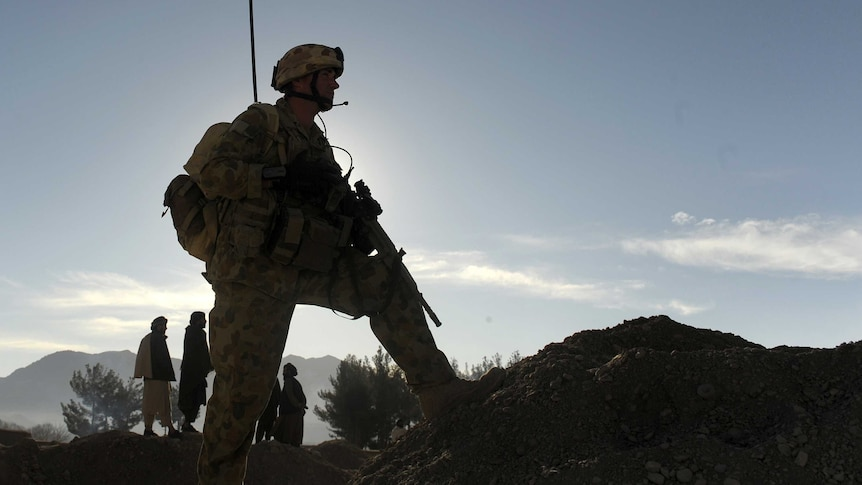 The silhouette of an Australian soldier is pictured against mountains in Afghanistan.
