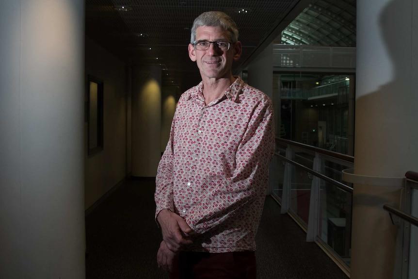 John Slaytor poses in a hallway