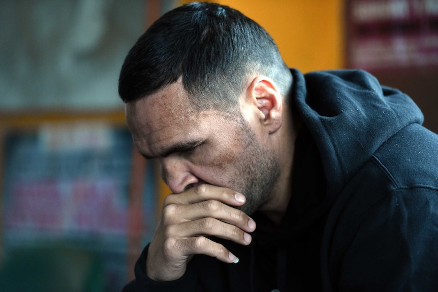 Boycott call ... Anthony Mundine at a media conference at his Redfern gym in Sydney