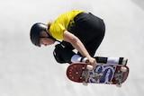 Poppy Olsen gets some air on her skateboard.