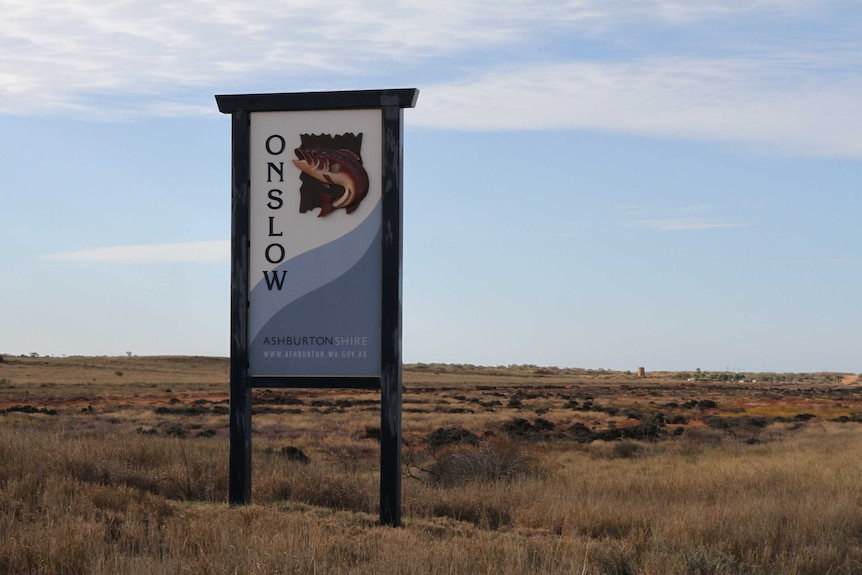 A roadside sign featuring an illustration of a fish and the word 'Onslow'.