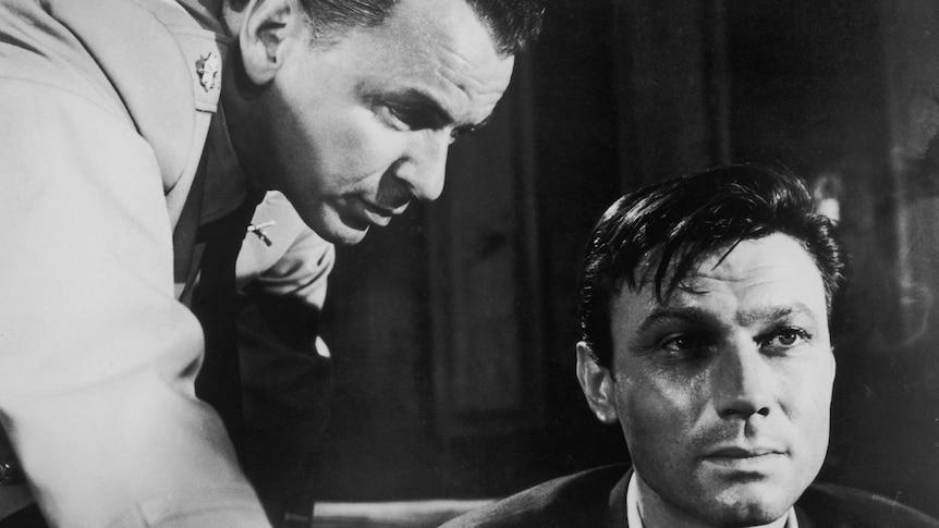 Two men in an interrogation scene