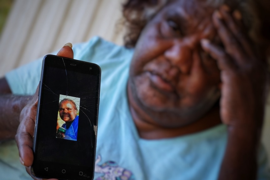 Louise Rankine holds a photo of her daughter Kwementyaye Green, who was found dead in Tennant Creek in 2013.