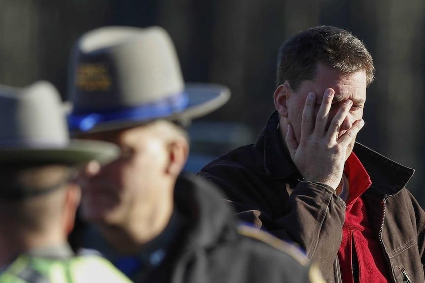 Man grieves at scene of school shooting