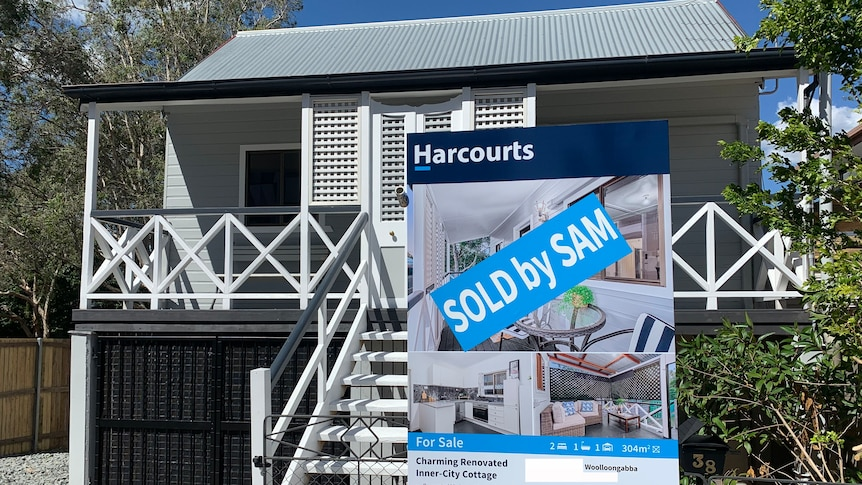 Renovated wooden cottage with Sold sign in Brisbane