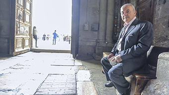 Wajeeh Nusseibeh sitting inside the Church of the Holy Sepulchre.