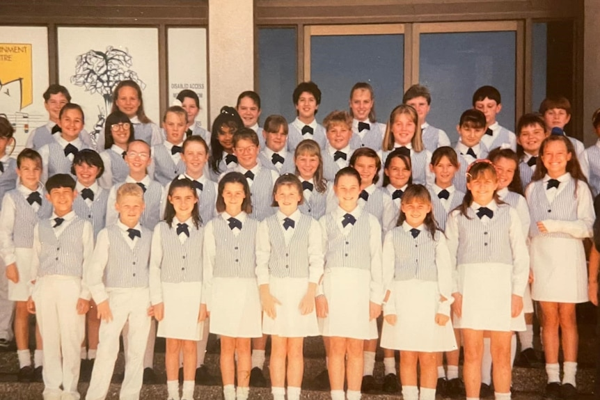 A group photo of a school year, including teaching staff.