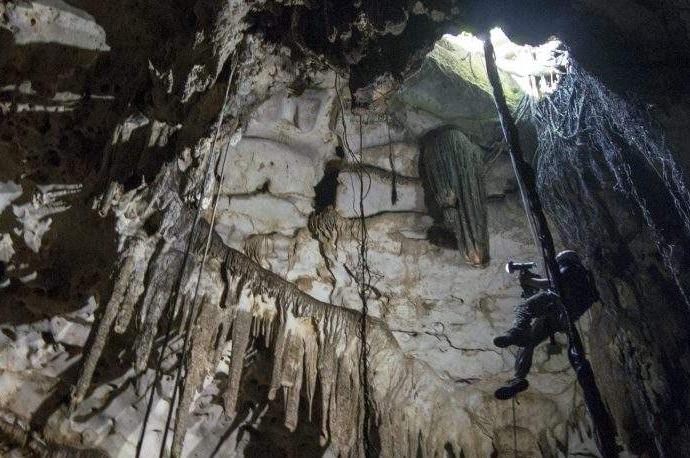 Engineer Corey Jaskolski scans the entrance to Cenote Holtun in Chichen Itza, Mexico.