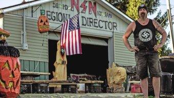 "Daniel Burnside, a self-described ""proud racist""' stands in front of his home."
