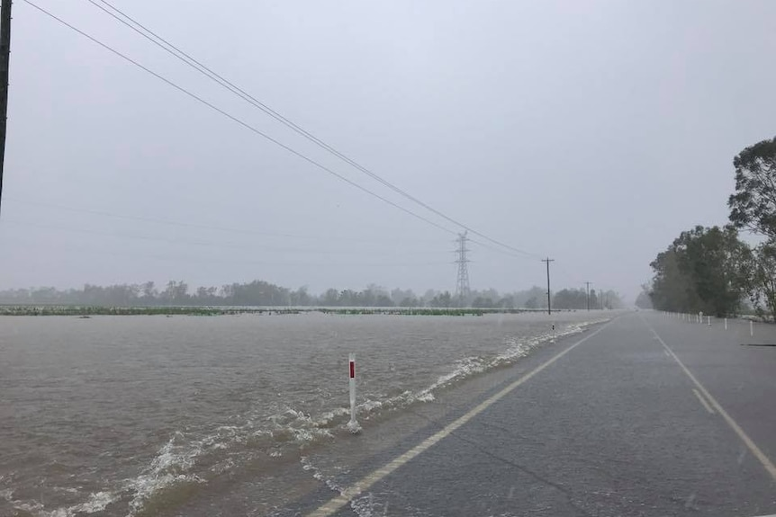 Water lapping up on the side of Bruce Highway.