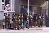 Troops patrol the streets of Zimbabwe's capital, Harare