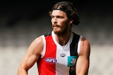 Dylan Roberton holds the ball in two hands as he plays against North Melbourne during the 2020 AFL season.