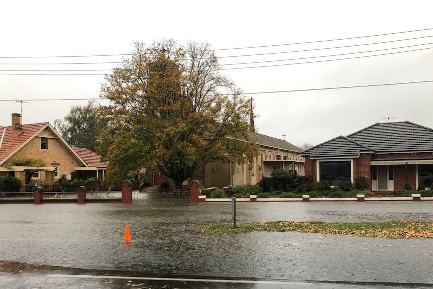 Water floods a residential street in Lake Wendouree.