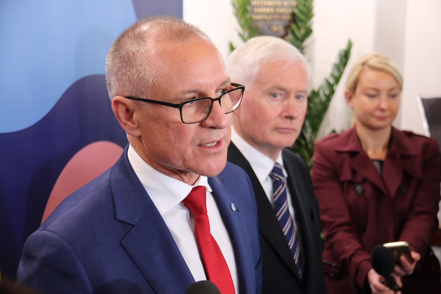 Premier Jay Weatherill stands side by side with John Rau