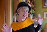 A woman dresses as a bee