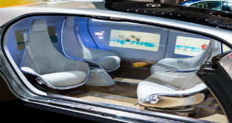 A futuristic looking interior of a driverless car