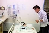 Melina, in bed, asks nurse Alice Lee questions