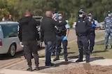 Men speak to police at Rookwood Cemetery