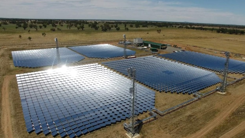 Aerial photo of five large sections of solar panels as part of a renewable energy project