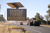 A roadside sign informs people to have a border permit to enter Victoria.