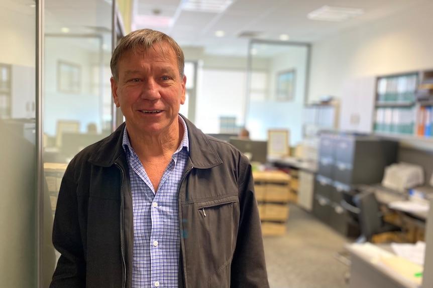 Dairy industry consultant Wolfie Wagner standing in the Van Dairy office