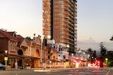A high-rise building stands above heritage buildings in Adelaide.