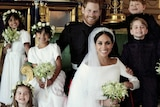 Meghan Markle and Prince Harry pose for an official photograph with flower girls and page boys