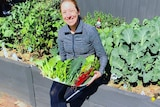 Rebecca Purvis with her vegetable garden in Melbourne's west.