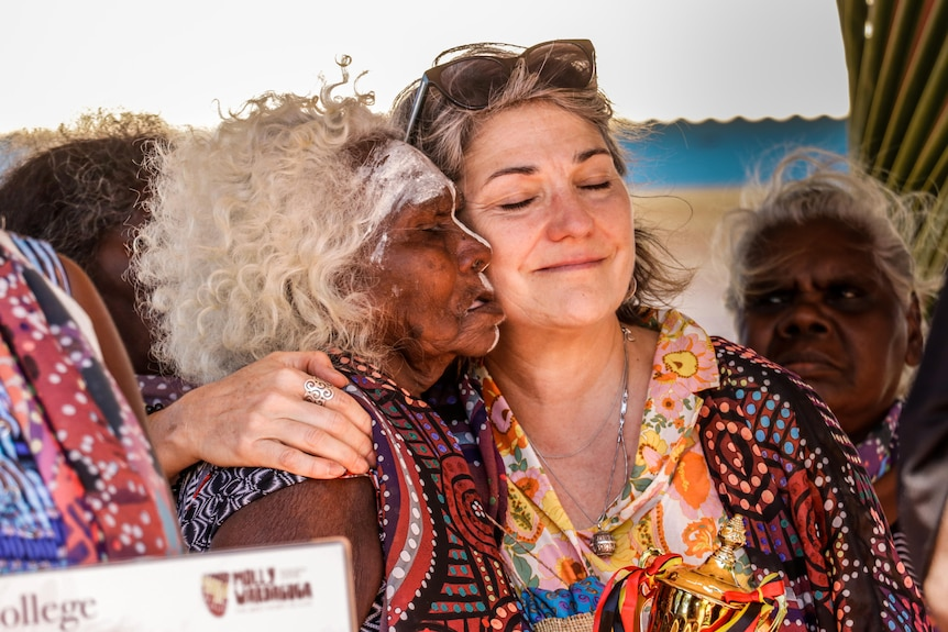 Elaine Guymun and Renee Adair embrace after the graduation ceremony for the doula program in East Arnhem Land.