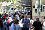 People walk through Brisbane mall