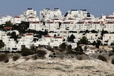 The Israeli settlement of Maaleh Adumim looms over Arab Bedouin shacks in the West Bank.