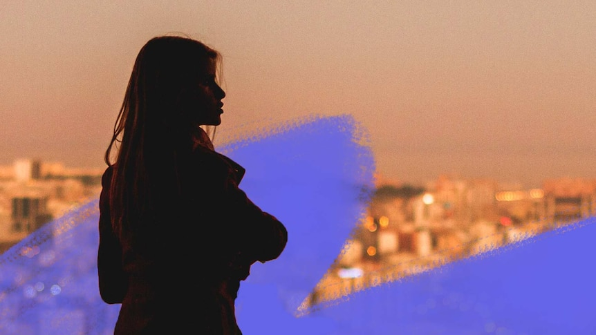 Woman in silhouette looking over city