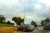 Police dashcam footage of car bringing down power lines