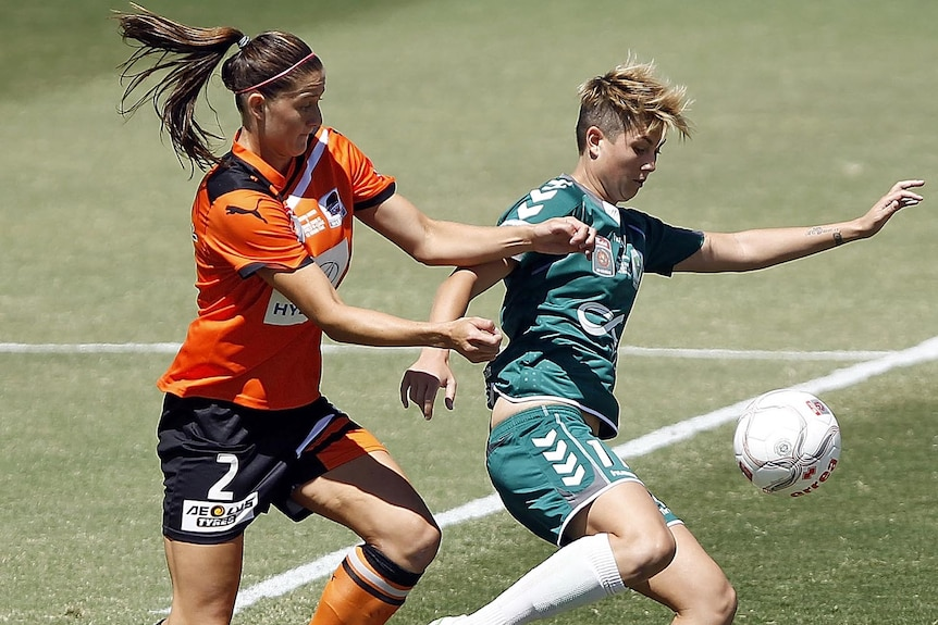 Canberra United's Michelle Heyman and Brisbane Roar's Laura Alleway contest possession during the 2012 W-League Grand Final.