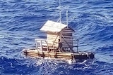 The teenager is seen on a wooden fish trap floating in the sea.
