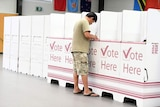A voter at a polling booth in the Qld election at Inala State School on Brisbane's south-west.