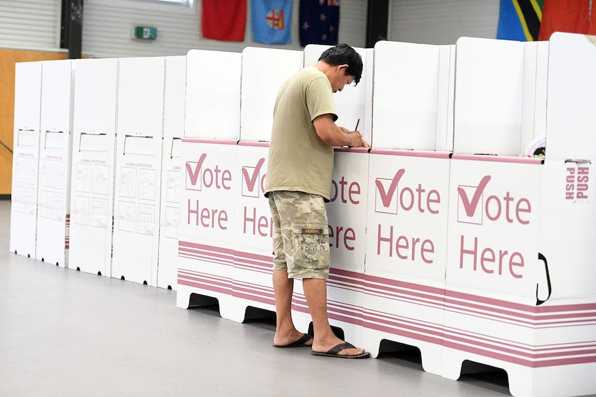 A voter at a polling booth in the Queensland election at Inala State School on Brisbane's south-west.