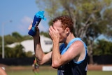 Darwin Buffaloes player in hot weather