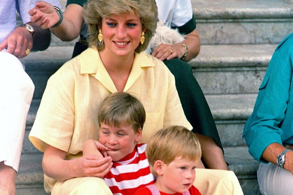 Princess Diana sits close to ger young sons, Princes William and Harry, in 1987 .