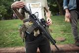 Dwayne Dixon carries an assault rifle in Charlottesville.