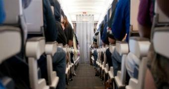 An aisle on a passenger jet.