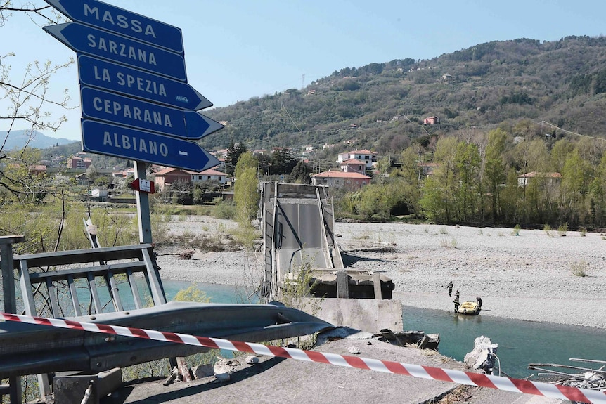 The debris of a bridge lies on a river bed after the bridge collapsed in Aulla.