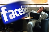 Man slumps in front of his laptop compiled with the Facebook logo