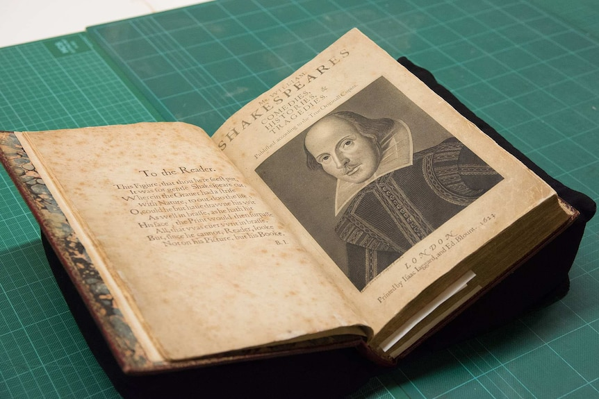 A close-up of the old book, which is open