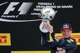 Red Bull driver Max Verstappen holds the trophy after winning the Spanish Formula One Grand Prix.