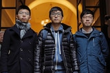 From left, Joshua Wong, Alex Chow and Nathan Law walk out from the Court of Final Appeal in Hong Kong